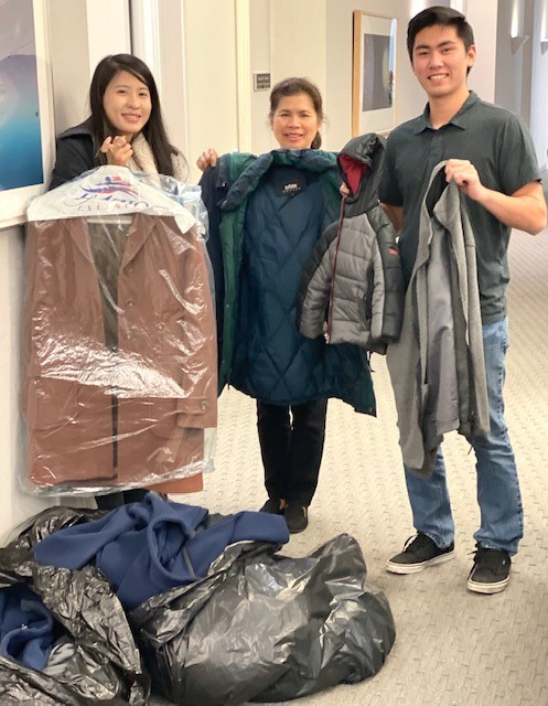 The GS team donates winter coats for its holiday charity